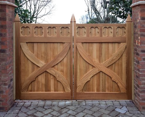 A pair of bespoke Iroko hardwood Artemis gates installed on brick piers