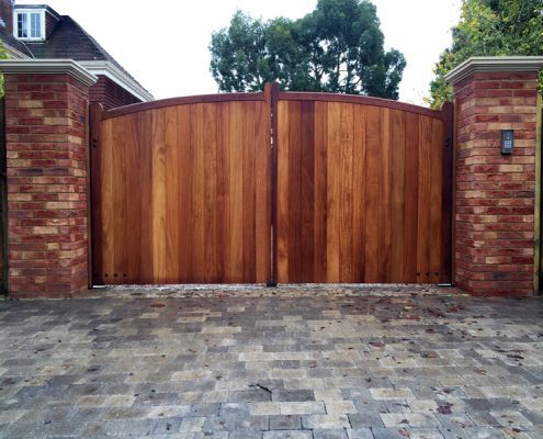 Iroko Cranborne gates installed on brick piers