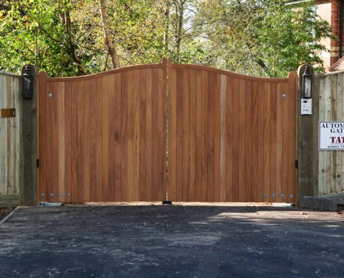 A pair of hardwood Iroko Cranborne gates on softwood posts