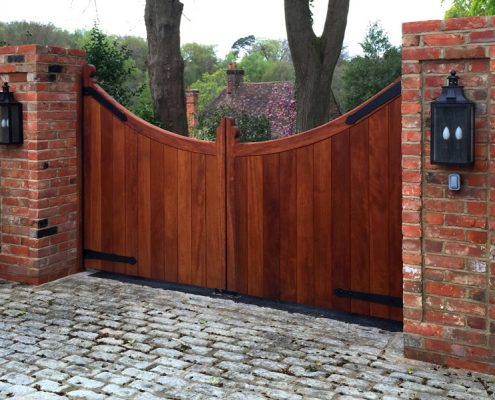 A pair of Iroko hardwood scalloped gates