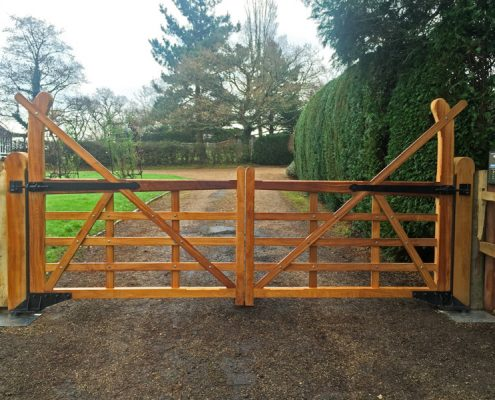 Iroko yeoman 5bar style gates on underground operators
