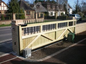 Sliding timber gate with metal infills