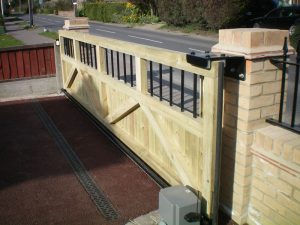 Sliding tracked timber gate with infills