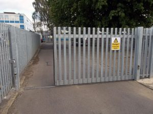 Steel palisade sliding tracked gate